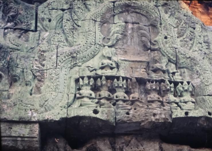 DSC04795 7.24 ta prohm pediment w 3-headed (horses?) squatting figs x 7
